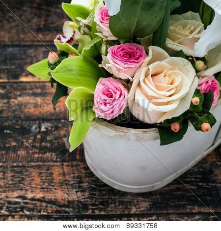 Roses In Vase On Wooden Table