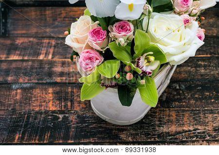 Vintage Roses In Vase On Wooden Table