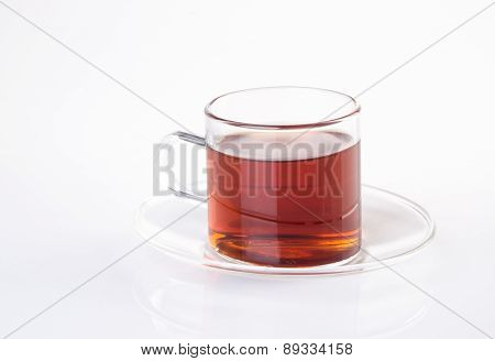 Tea In Glass Cup On A Background. Tea In Glass Cup On A Background