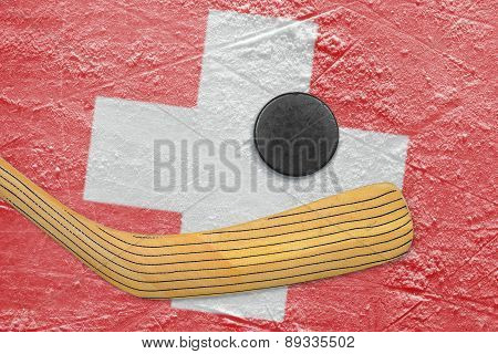 Hockey Puck, Hockey Stick And The Swiss Flag
