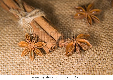 Star Anise And Cinnamon Sticks On Old Cloth