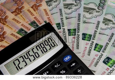 The Calculator On The Background Of Russian Money.