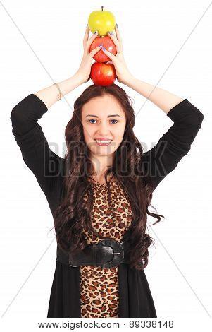 Teen Girl Holds An Three Apples On Her Head