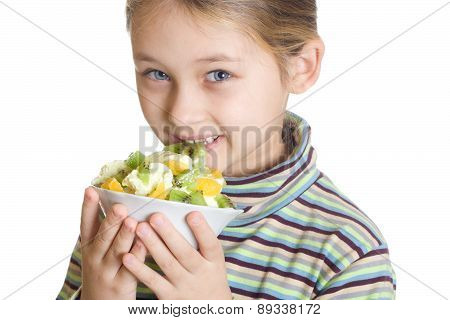 Child Eats Dessert With Ice Cream