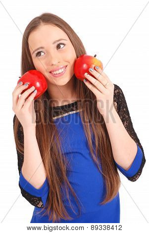 Young Girl Holds Near The Face Apples
