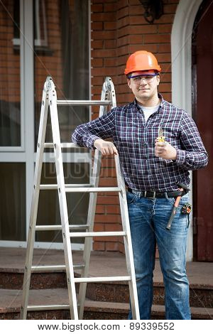 Happy Worker On Building Site Holding Thumbs Up