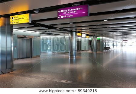 London Heathrow Airport Interior with Gate Departure Signs.