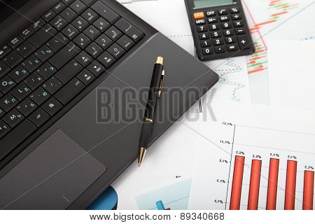 Calculator, Laptop,tablet And Financial Documents