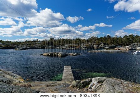 Bridge In A Small Rocky Bay On The Fjord
