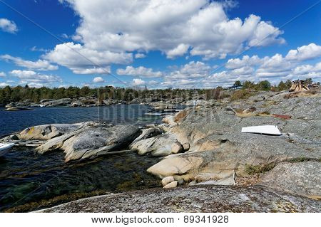 Rocky Shore Of A Norwegian Fjord Bay In The Spring