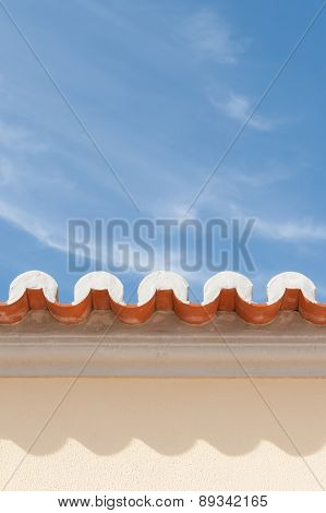 View Of Roof Eaves With Tiles & Sky