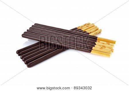 Crackers Stick And Coated With Black Chocolate On White Background