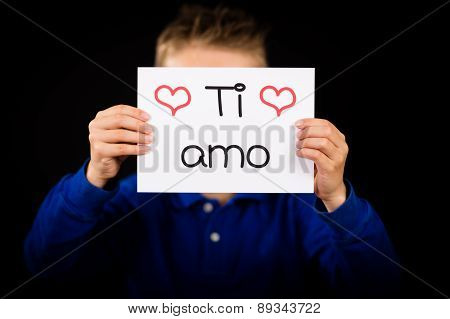 Child Holding Sign With Italian Words Ti Amo - I Love You