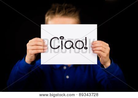 Child Holding Sign With Italian Word Ciao - Hello