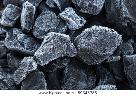 Close Up Of Chunks Black Coal On Which The Rime