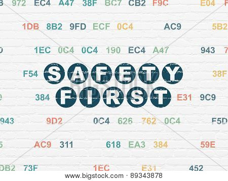 Security concept: Safety First on wall background