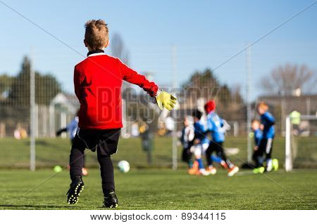 Young Goalie During Soccer Match