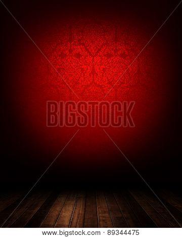 dark interior room with red wallpaper.