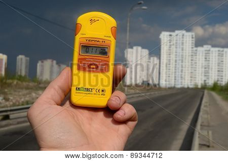 Kiev, Ukraine -April 29, 2015: Measuring radiation levels in the residential area of Kiev after huge forest wildfire in Chernobyl Area on April 28. Kiev April 29,, 2015  Kiev, Ukraine.