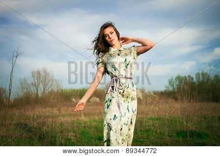 young woman in summer  dress enjoy in grass field