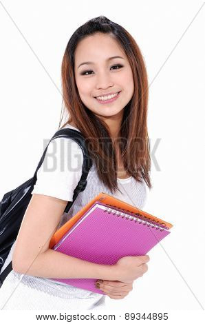 Young girl smiling with backpack ,holding book-white background