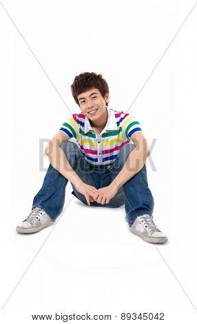 young Casual asian man sitting on the floor