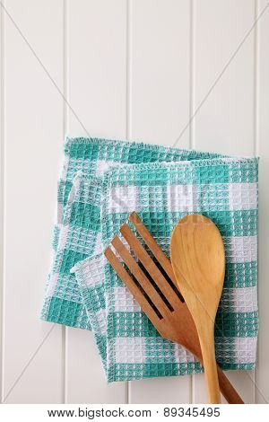 wooden fork and spoon on top of the table cloth