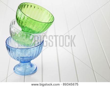 three colorful empty drssert or salad bowl