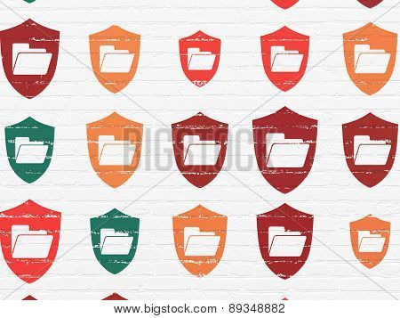 Business concept: Folder With Shield icons on wall background