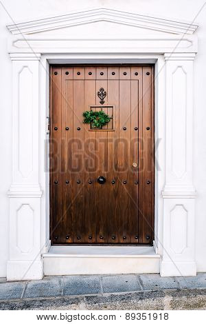 Brown Door With Christmas Decoration