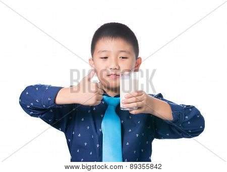 Asian Boy Giving You Thumbs Up With Glass Of Milk In Hand