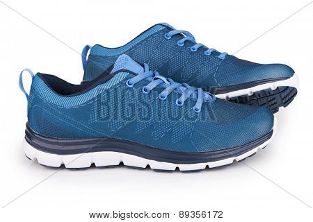 Blue sneakers with shadow isolated on white