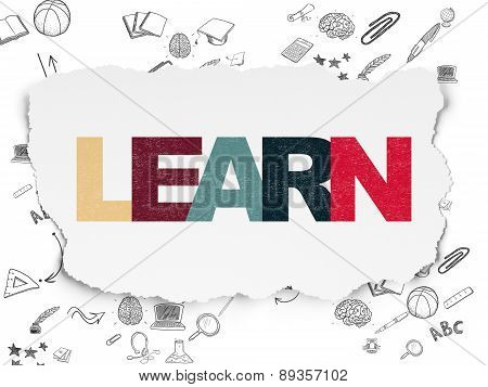 Education concept: Learn on Torn Paper background