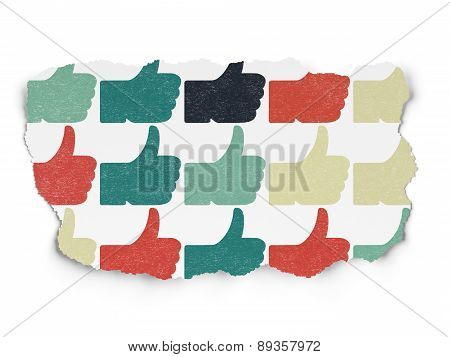 Social media concept: Thumb Up icons on Torn Paper background