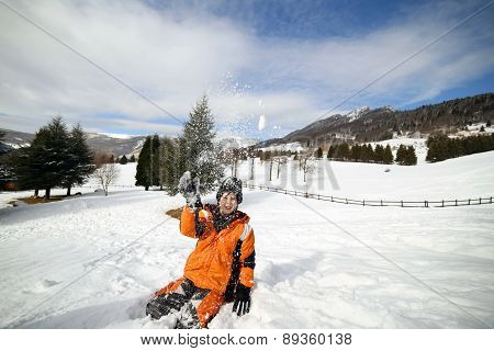 Cute Little Boy Play With Snow In The Mountains