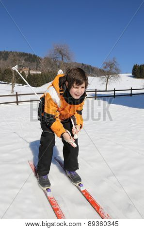 Young Boy Goes On Cross-country Skiing On The White Snow In The Mountains