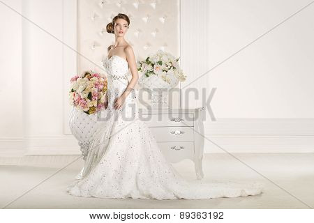 Gorgeous Bride With White Dress With Flowers Bouquet