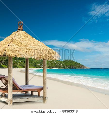 beach beds with roof and turquoise sea