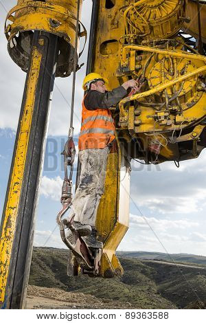 Construction worker fixing drilling pile foundation.