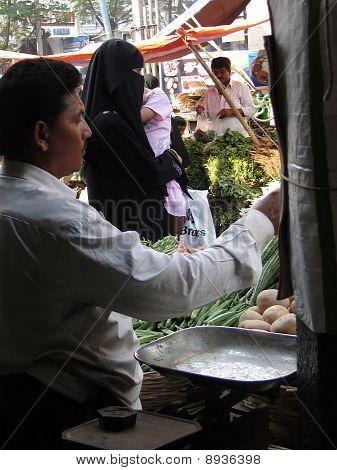 Veiled Muslim Women Shop In The Lad Bazaar