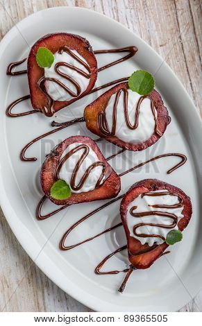 Pears Cooked In Red Wine With Whipped Cream
