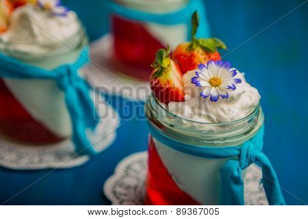 Jelly Dessert With Whipped Cream And Strawberries