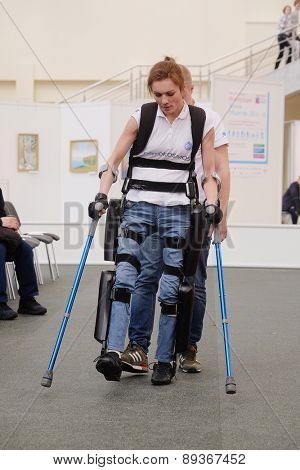 MOSCOW, RUSSIA - APRIL 22, 2015: Demonstration of an ekzoskeleton at an exhibition of the rehabilitation equipment for disabled people