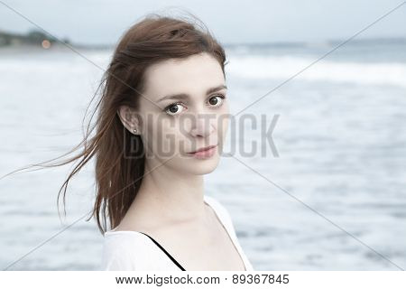 Full lenght portrait of beautiful girl on the beach