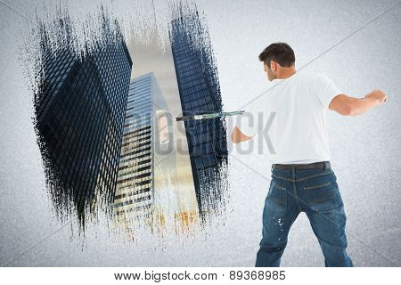 Man using paint roller on white background against low angle view of skyscrapers