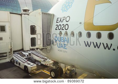 DUBAI - NOV 12: docked Airbus A380 aircraft on November 12, 2014 in Dubai, UAE. Emirates handles major part of passenger traffic and aircraft movements at the airport.