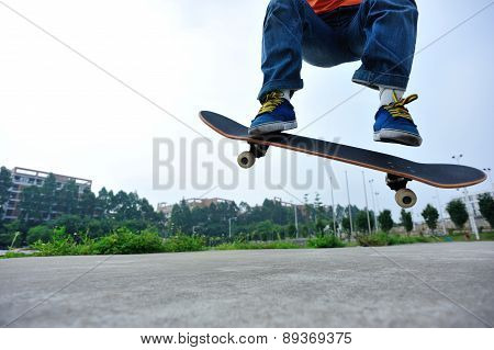 young skateboarder skateboarding outdoor