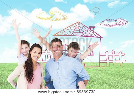 Loving parents giving piggyback ride to children against blue sky over green field