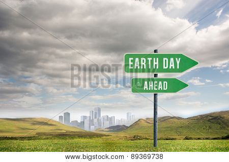 earth day ahead against large city on the horizon