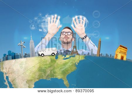 Businessman with arms raised and his fingers spread out against blue sky